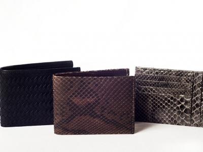 portafogli uomo: pelle di pitone e pelle intrecciata. Leather wallets