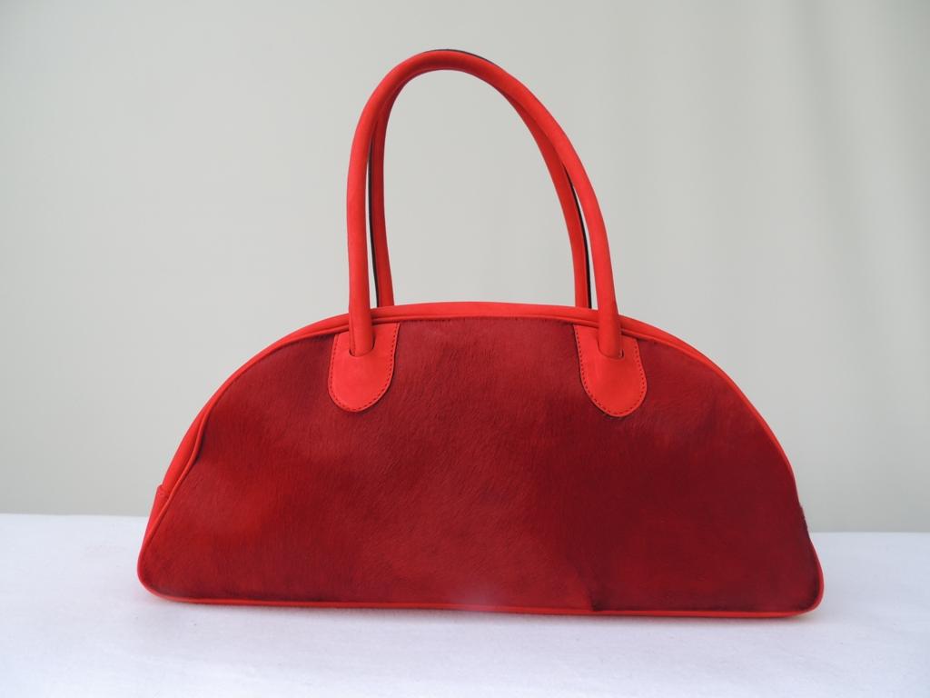 borse artigianali e accessori in pelle: borsa in cavallino rossa