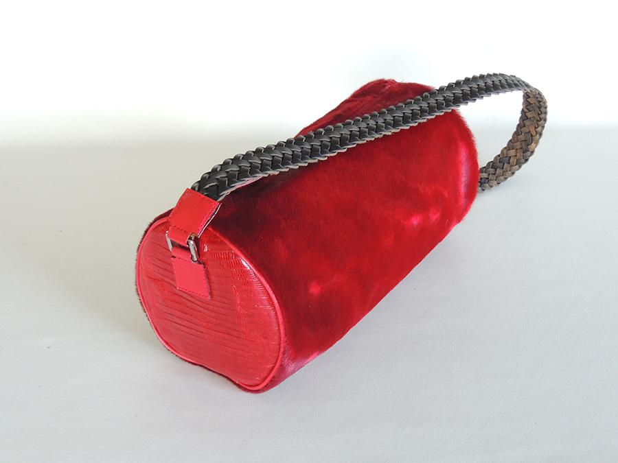 borsa cilindrica in tejus e cavallino con manico in cuoio intrecciato- borsa rossa