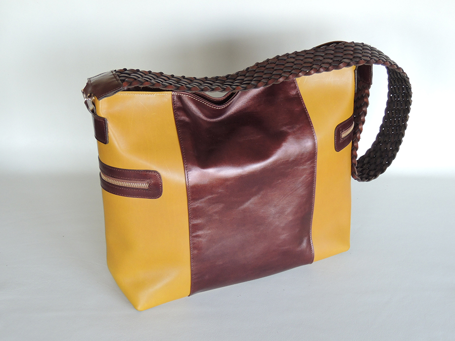 borsa da donna in pelle con manico intrecciato in cuoio
