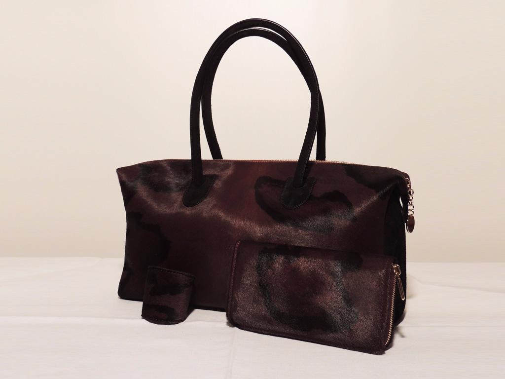 set di accessori in pelle di cavallino: borsa portafoglio e bracciale