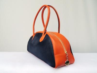borsa in pelle di cavallino nero arancione