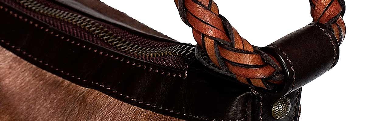 dettagli di borse in pelle artigianali fatte a mano